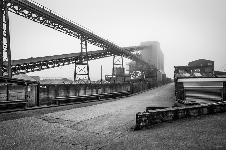 Agregate grading plant in fog at Hall Wharf on Basin Road North, Portslade Sussex UK. Black and white industrial photograph. © P. Maton 2015 eyeteeth.net