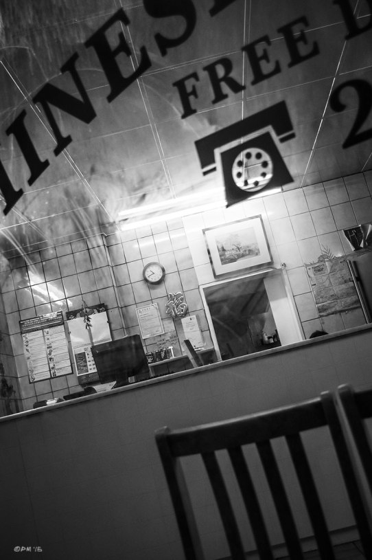 View through window of Chinese take-away , New England Road Brighton UK. Monochrome Portrait. © 2015 P. Maton eyeteeth.net