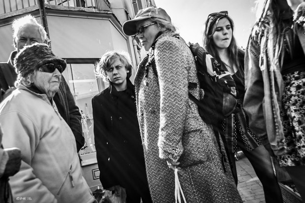 Old ladies in hats, coats and sunglasses with young man looking on and young woman walking passed, street scene with sun flare across image. Kensington Gardens North Laine Brighton UK. Monochrome Landscape. © P. Maton 2015 eyeteeth.net