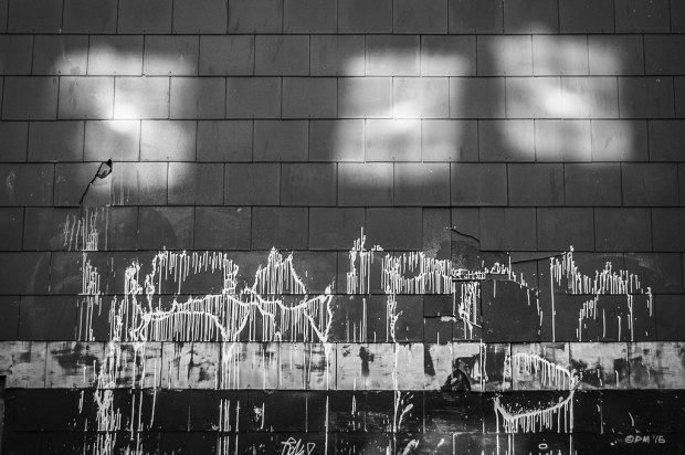 Reflected light patches on tiled wall with paint drizzle. Astract urban street. Kensington Street Brighton Uk. Monochrome Landscape. © P. Maton 2015 eyeteeth.net
