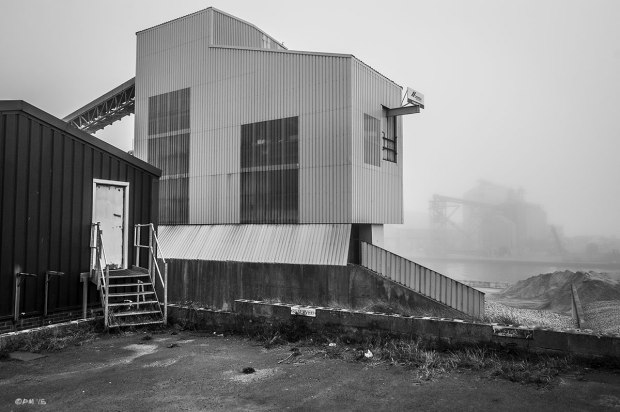 Carpark and aggregates grading plant building with harbour in misty background, Halls Wharf,  Wellington Road Portslade Sussex UK. Monochrome Landscape. © P. Maton 2015 eyeteeth.net