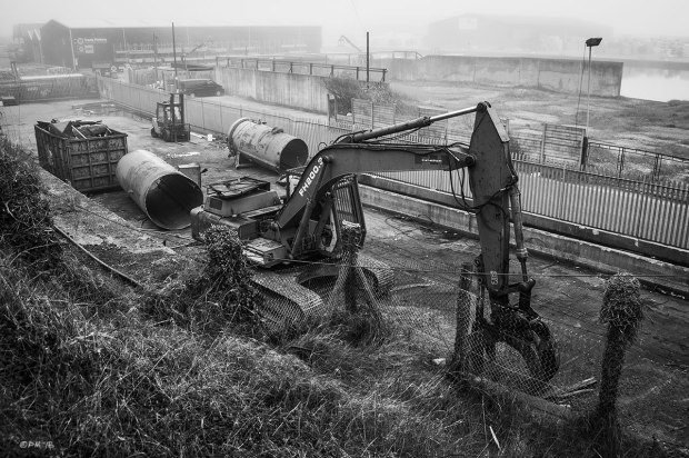 Industrial wharf with caterpillar tracked grab, forklift truck and dismantled chemical tank fading into mist. Basin Road North Portslade Sussex UK. Monochrome Landscape. © P. Maton 2015 eyeteeth.net