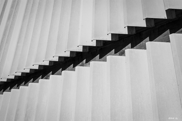 Gap between panels on corrugated metal wall. Abstract urban street photography. Ship Street Brighton UK. Monochrome Landscape. © P. Maton 2015 eyeteeth.net