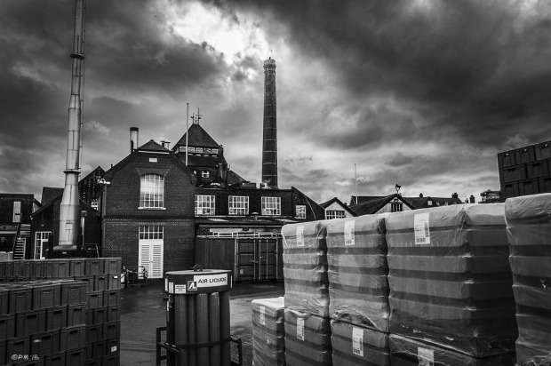 Sun breaking through dark clouds over Harvey's Brewery chimney, Lewes East Sussex UK. Monochrome Landscape. © P. Maton 2015 eyeteeth.net