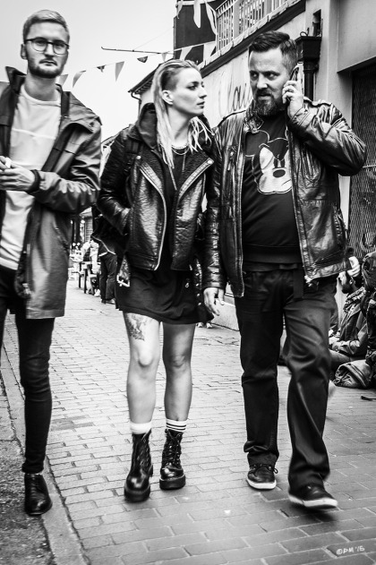 Three hipsters walking towards camera, girl and guy in leather jackets on Kensington Gardens Brighton UK. Monochrome Portrait. © P. Maton 2015 eyeteeth.net