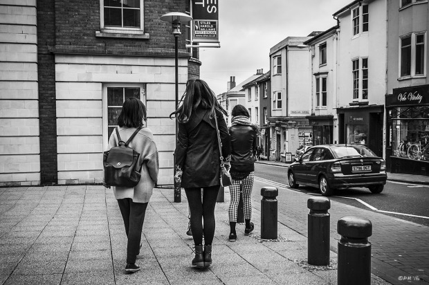 Young woman with feet off the ground levitating or jumping. Trafalgar Street Brighton UK. Old Shoreham Road Brighton UK. Urban Street Photography. Monochrome Landscapet. © P. Maton 2015 eyeteeth.net