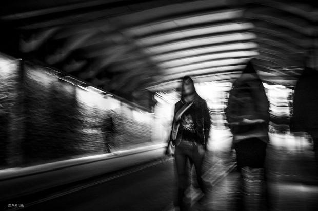 People walking in tunnel with motion blur and camera shake.  Trafalgar Street Brighton UK. Gloucester Road Brighton UK.Urban Street Photography. Monochrome Landscape. © P. Maton 2015 eyeteeth.net