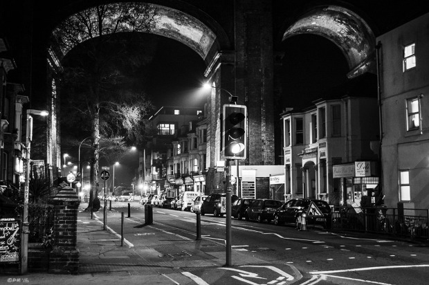 Victorian viaduct arches spanning illuminated street at night, Preston Road Brighton UK. Urban Monochrome Landscape. © P. Maton 2015 eyeteeth.net