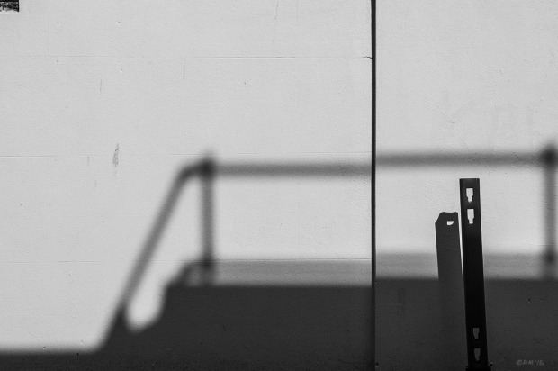 Shadows of railings cast on white painted concrete wall with post. Abstract Urban Street photography. Barrack Yard Brighton UK. Monochrome Landscape. © P. Maton 2015 eyeteeth.net