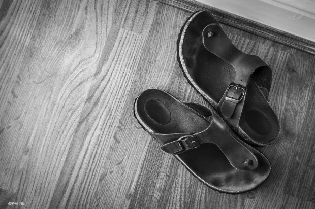 Birkenstock sandals placed in opposing directions  on fake Oak wood floor. Abstract. Hove UK.  Monochrome Landscape. © P. Maton 2015 eyeteeth.net