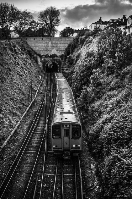 Train moving along line towards camera from Hove Tunnel taken from  bridge on New England Road Brighton UK. Monochrome Portrait. © P. Maton 2015 eyeteeth.net