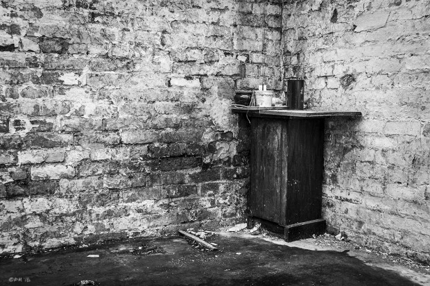 Dilapidated cabinet in corner of crumbling brick walls. Bexhill on Sea UK.  Monochrome Landscape. © P. Maton 2015 eyeteeth.net
