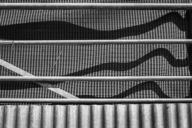 Shadows cast by gate bars on plastic mesh, barn gate Middle Farm East Sussex UK. Abstract Monochrome Landscape. © P. Maton 2015 eyeteeth.net