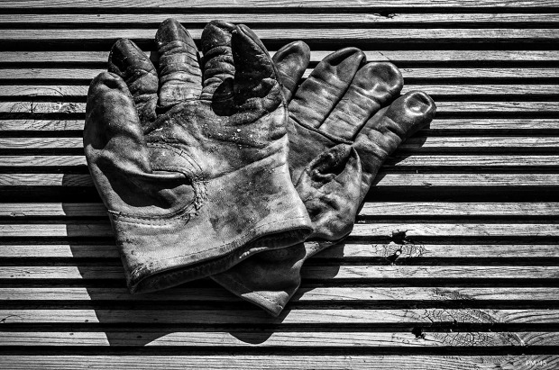 Worn leather work gloves on decking. Monochrome Landscape. © P. Maton 2015 eyeteeth.net