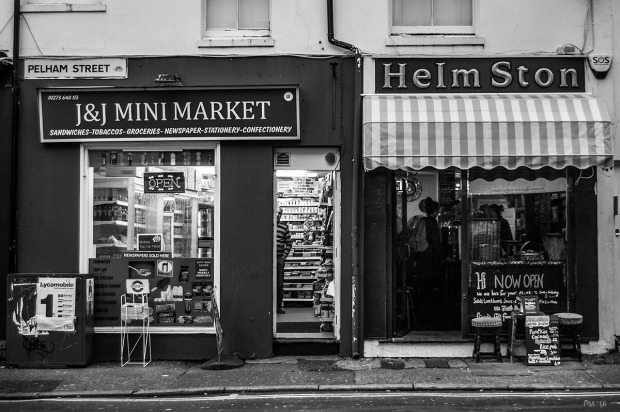 Two shop fronts on Pelham Street J & J Mini Market and Helm Ston . Brighton, Sussex UK. Monochrome landscape. © P. Maton 2015 eyeteeth.net