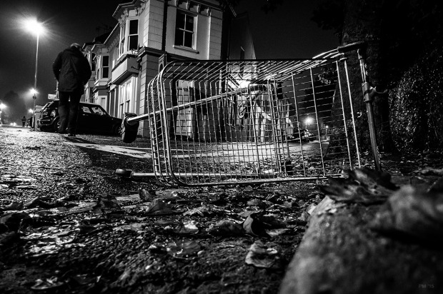 Shopping trolley lying in gutter with man walking passed, Chatham Place Brighton UK. Urban Street photography. Monochrome Landscape. © P. Maton 2015 eyeteeth.net