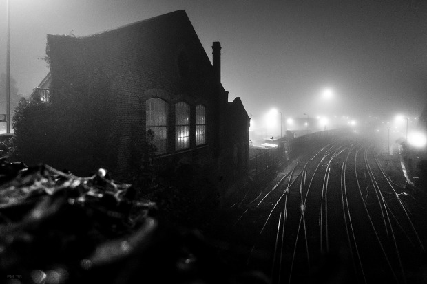 Victorian railway building at night in fog lights reflected in windows. Brighton Train Care Depot, Combined Engeneering Depot. Brighton Sussex UK. Urban Monochrome Landscape. © P. Maton eyeteeth.net