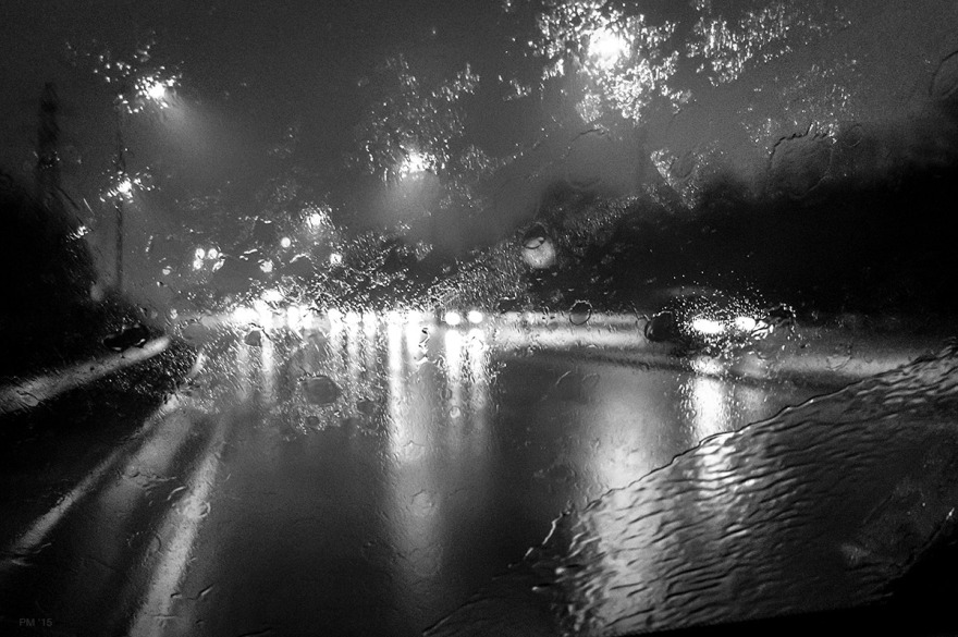 Rain on windscreen at night with wet road and car headlights. A27 Lewes East Sussex UK. © P. Maton 2015 eyeteeth.net