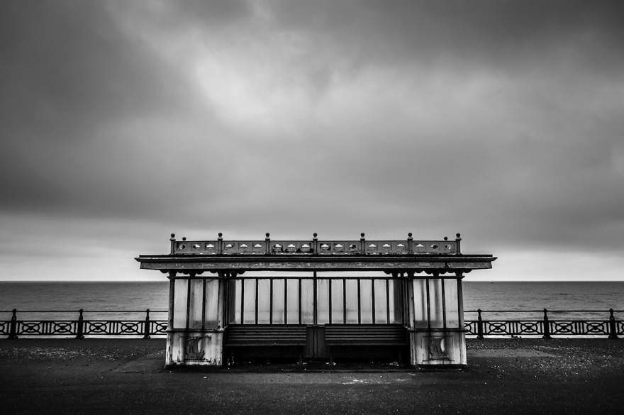 Victorian benches on Western Esplanade, Hove seafront. Grey evening with heavy cloud. Monochrome Landscape. © P. Maton 2015 eyeteeth.net