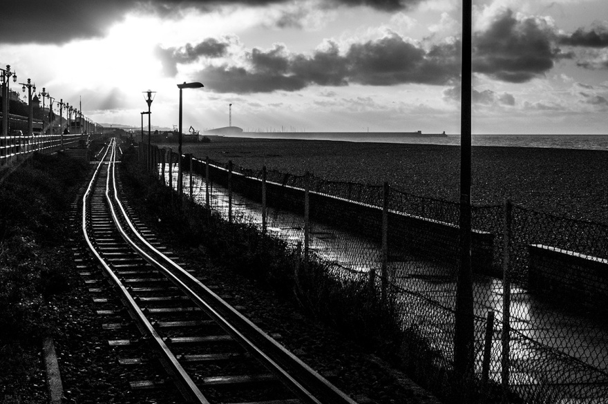 Morning sun on Volks railway tracks on Brighton seafront. Brighton East Sussex UK. Black and white urban landscape photograph. © P. Maton 2014 eyeteeth.net