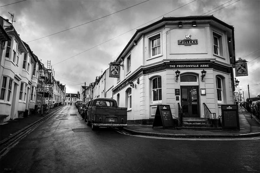 Prestonville Arms pub on an overcast rainy day with view up Brigden Street, Brighton UK. Urban Street photography. © P. Maton 2016 eyeteeth.net
