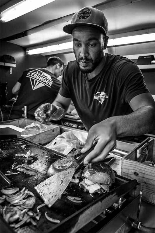 Man cooking onions on street burger van, Iceberger Brighton UK. Black and white street photography. © P. Maton 2016 eyeteeth.net
