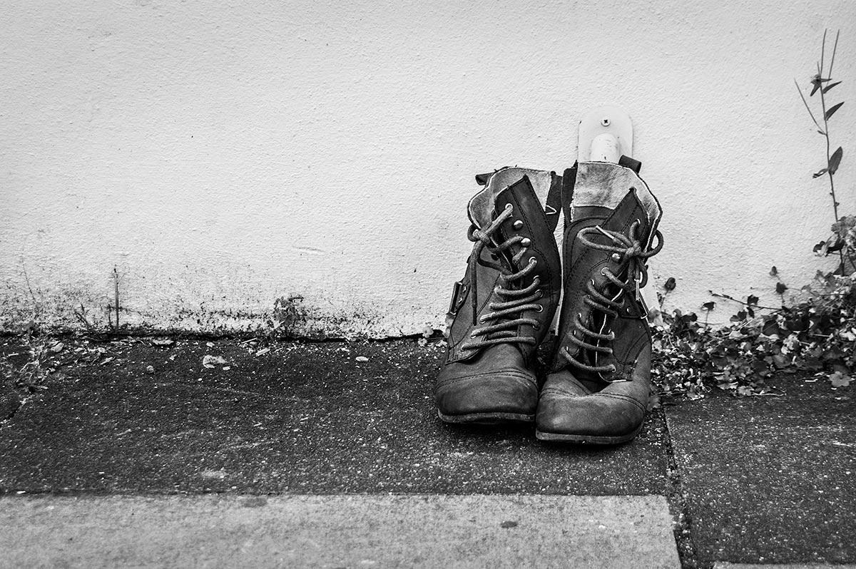 abandoned boots on street, Brighton UK. Black and white street photography. © P. Maton 2016 eyeteeth.net