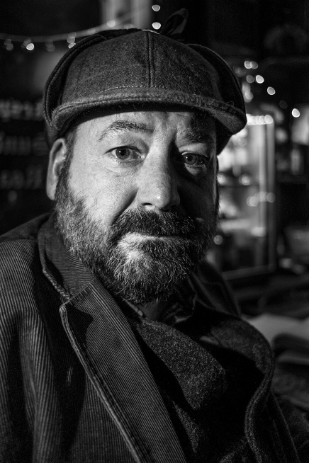 Man with beard and deerstalker hat sitting in a pub bar. Brighton UK Britain English culture and emotion. Black and white portrait photograph. © P. Maton 2016 eyeteeth.net