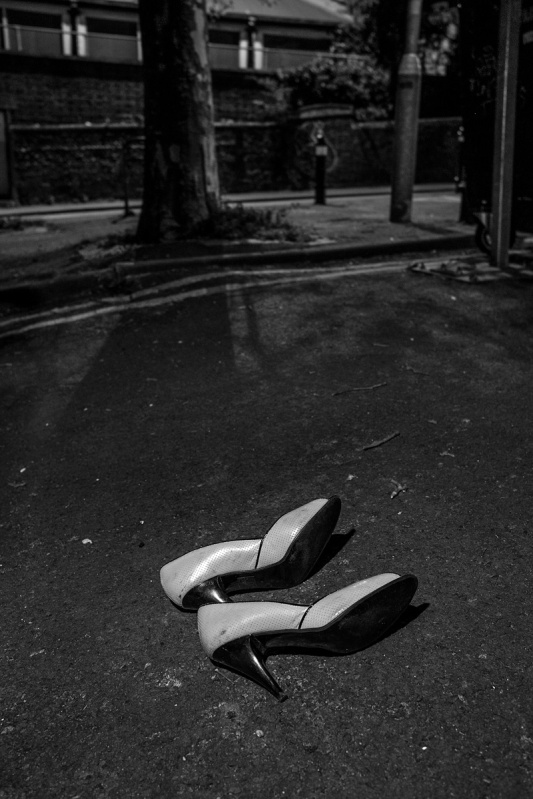 High heel shoes lying on road  at night. York Grove Brighton UK. Black and white urban street photography. © P. Maton 2017 eyeteeth.net