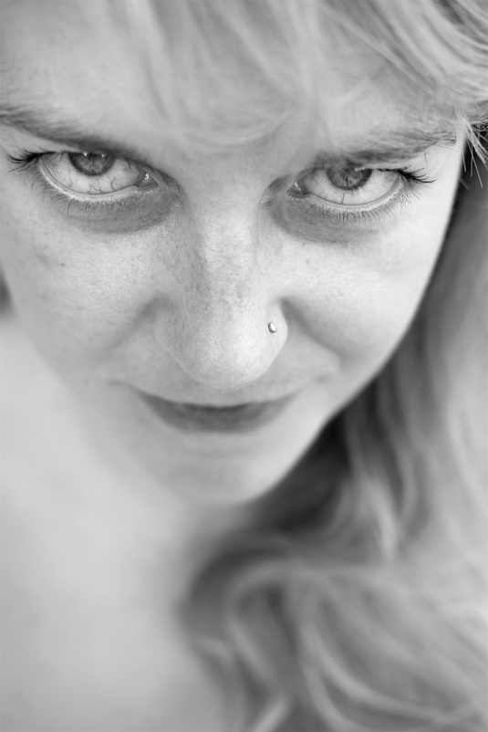Portrait of woman with intense eye looking up at camera natural skin beauty black and white photography © P. Maton 2017 eyeteeth.net