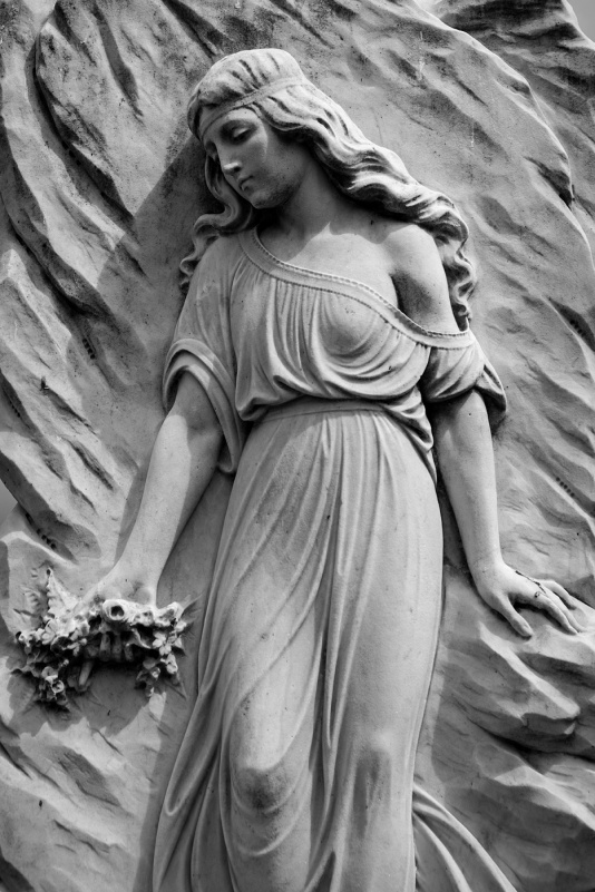Bass relief carved headstone of woman holding flowers, Hove Cemetery Sussex UK black and white portrait  P. Maton 2017 eyeteeth.net