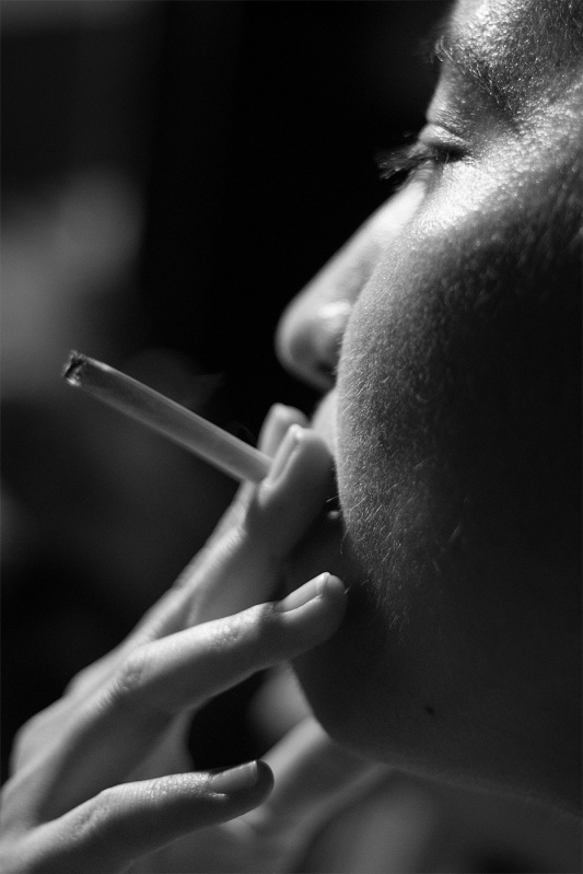 Woman smoking close up black and white profile portrait documentary photograph Yashica Auto Yashinon DS-M 50mm 1.4 Fujifilm XT-2 ©P. Maton 2017 eyeteeth.net