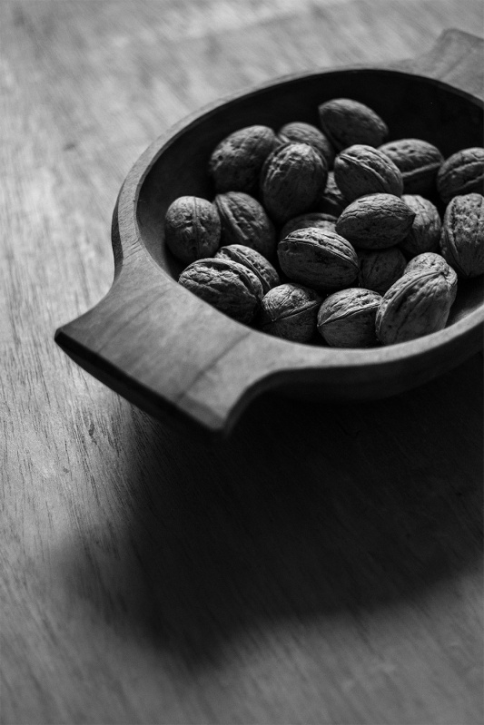 Walnuts in a hand carved wooden bowl black and white still life portrait photograph  P. Maton 2017 eyeteeth.net