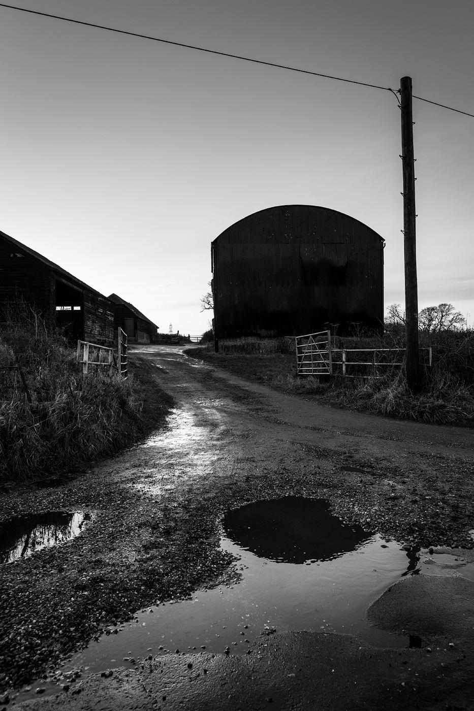 Barn over wet road, Turks Lane, Mortimer Common, Berkshire UK black and white rural documentary landscape portrait photograph © P. Maton 2017 eyeteeth.net