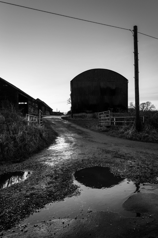 Barn over wet road, Turks Lane, Mortimer Common, Berkshire UK black and white rural documentary landscape portrait photograph © P. Maton 2017 eyeteeth.net