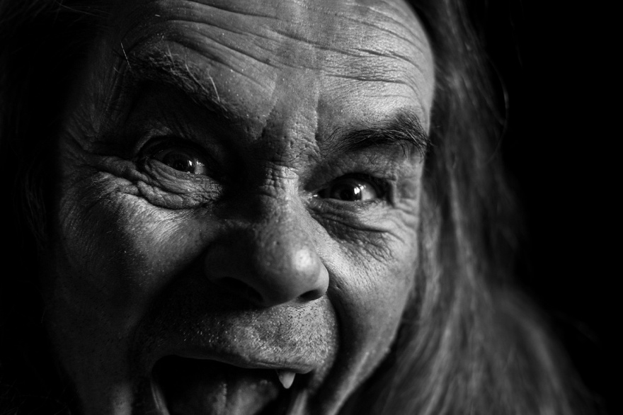 Senior man with missing teeth pulling face at camera, black and white documentary portrait photograph © P. Maton 2017 eyeteeth.net