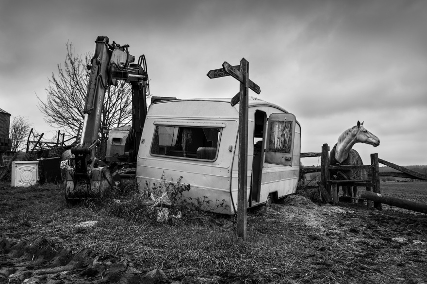 Abandoned caravan next to digger and horse by fence., rural black and white farm scene landscape, Poynings West Sussex UK. © P, Maton 2017 eyeteeth.net
