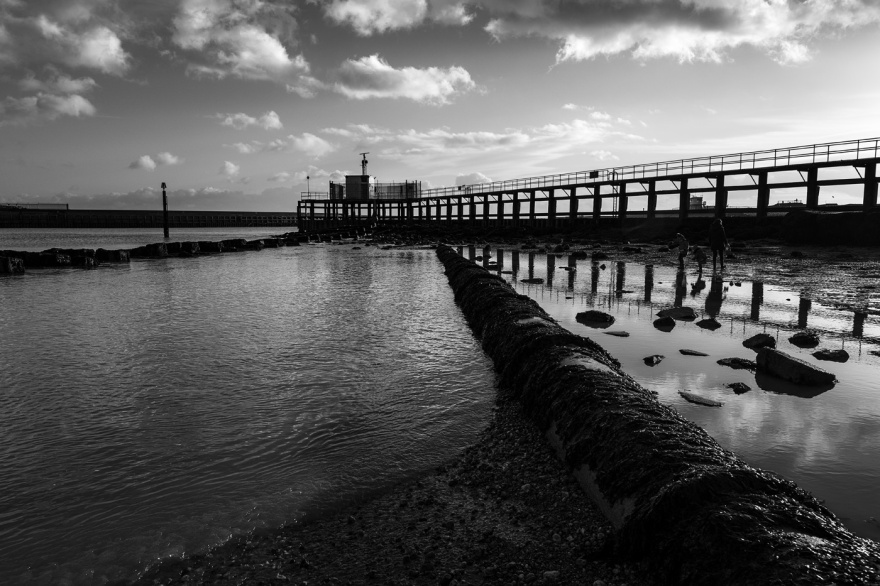 Pipeline and harbour arm jetty, Shoreham Harbour mouth of River Adur black and white documentary landscape © P. Maton 2018 eyeteeth.net