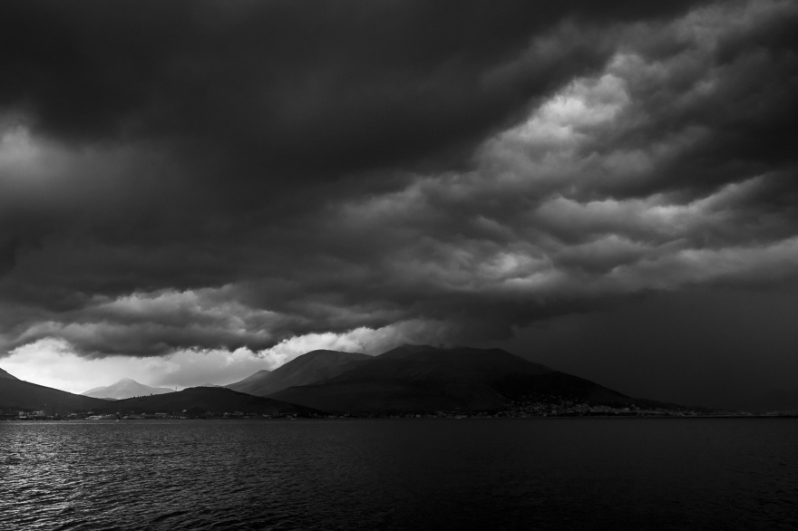 Dramatic thunder storm clouds gathering over port of Gaeta Italy viewed from the sea, black and white landscape ©P. Maton 2018 eyeteeth.net
