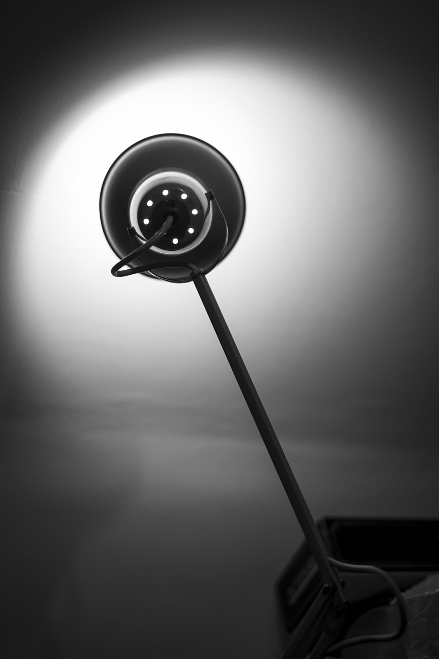 Standard lamp desk lamp pointed at wall with light falloff creating silhouette, black and white monochrome still life objects © P. Maton 2018 eyeteeth.net