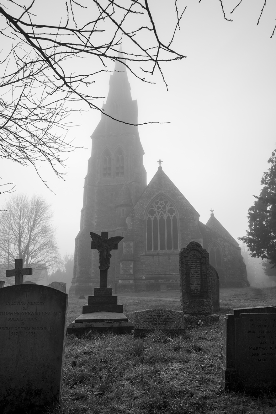 grave stones with church in fog, St. Mary the Virgin Stratfield Mortimer Berkshire UK black and white portrait composition documentary photograph ©P. Maton 2018 eyeteeth.net