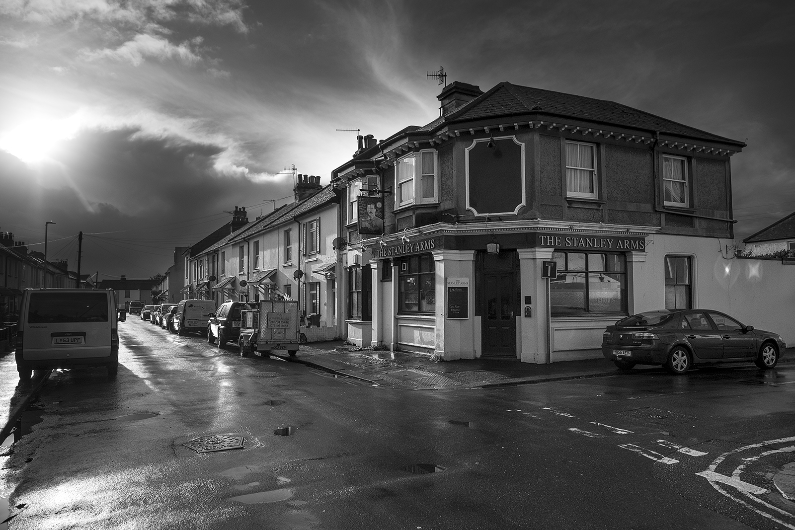 The Stanley Arms pub on Wolseley Road, Portslade, West Sussex UK, dramatic clouds and sunlight after rain, black and white urban landscape documentary photograph ©P. Maton 2018 eyeteeth.net