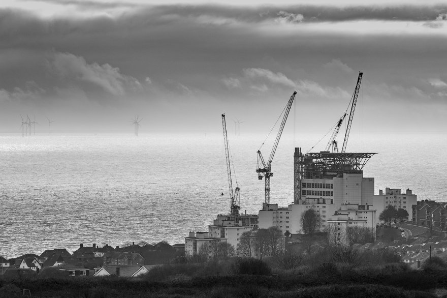 Construction work with cranes at Royal Sussex County Hospital with seascape and sky in background, black and white landscape photography Brighton Sussex UK ©P. Maton 2019 eyeteeth.net