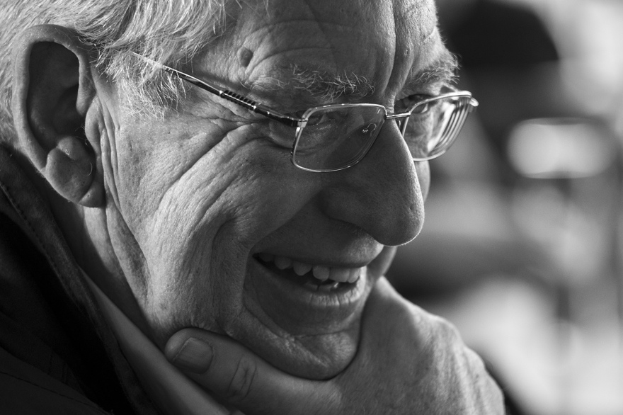 senior man in spectacles smiling, folk and sea shanty songs, The Boathouse in the Marina, Littlehampton West Sussex UK black and white portrait documentary culture folk music ©P. Maton 2018 eyeteeth.net