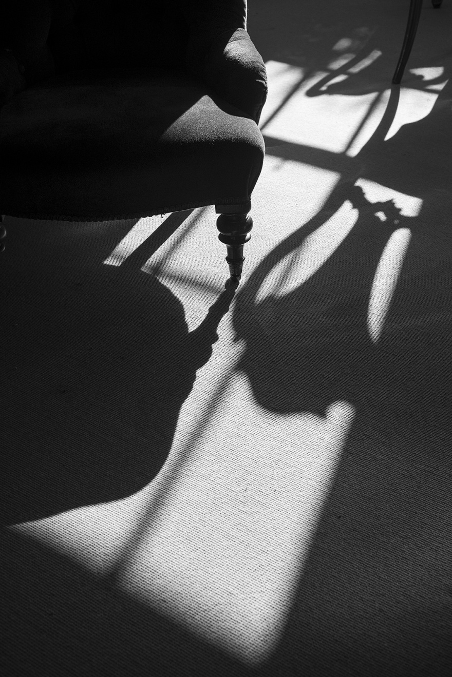 Abstract composition, sunlight through window casting shadows from chairs, Castle Hedingham Essex UK black and white interior abstract portrait ©P. Maton 2019 eyeteeth.net